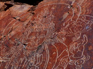 buddhist-looking-drawing-on-rock